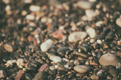 Sea pebble background. Sea pebble colorful wet background, vintage hipster image royalty free stock image