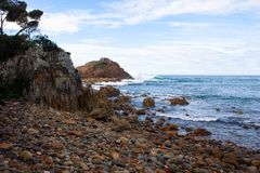 Pebble beach view with rocks stock photo
