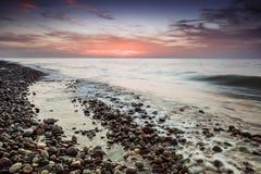 Sea pebble beach sunset Royalty Free Stock Photo