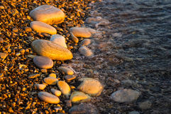 Free Sea Pebble Beach With Multicoloured Stones, Waves With Foam Royalty Free Stock Image - 96943706