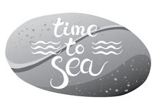 Sea pebble with lettering Stock Photos