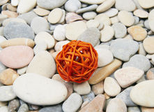 Sea pebble and orange sphere Stock Photo