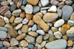 Sea pebbles background. Stones seamless pattern. seamless background with smooth pebble. stock photography