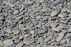 Sea pebbles background texture. The stone of the sea beach.  stock photo