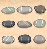 Sea pebbles collection on sand background Royalty Free Stock Photos