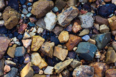 Sea pebbles and small stone gravel. Sea pebbles. Small stones gravel texture background.Pile of pebbles, thailand.Color stone in background Royalty Free Stock Photography