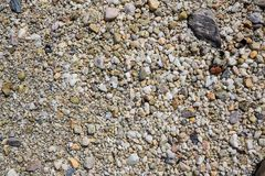 Sea pebbles. Small stones gravel texture background. Pebble stones background. Sea stone, Close up pebbles stone or white sea stone image use for web design stock image