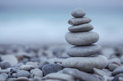 Sea pebbles tower closeup. At dusk against azure coat. Shot taken at French Riviera, Mediterranean sea Royalty Free Stock Photo