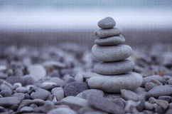 Sea pebbles tower closeup. At dusk against azure coat. Shot taken at French Riviera, Mediterranean sea Stock Photos