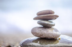 Sea pebbles tower closeup. Pebbles sculpture made on Barcelona beach. Beautiful soft background Royalty Free Stock Image