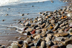 Sea pebbles washed by wave. Beach, sea pebbles washed by wave Stock Images