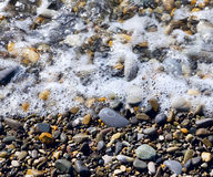 Sea pebbles and water Royalty Free Stock Photography