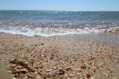 Sea pebbles and waves Royalty Free Stock Photography