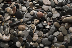 Sea pebbles. Wet pebbles. The image can be used as textural background Royalty Free Stock Photo