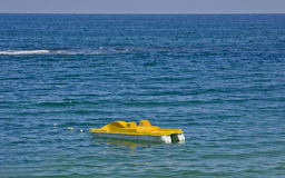 Sea pedal boat over blue water. Yellow sea pedal boat over nice blue water Stock Photos