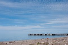 Sea pier, blue sky with light clouds royalty free stock photos