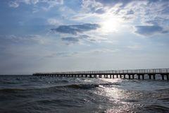 Sea pier and cloudy sky stock photography