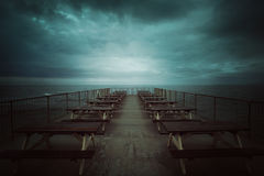 Sea pier and cold dramatic cloudscape Stock Image