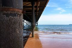 Sea pier in english riviera with beach and blue sky royalty free stock photo