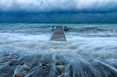 Sea pier during a hurricane at sea. Sea pier during the hurricane in the Mediterranean Sea in Turkey royalty free stock photography