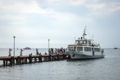 Sea pier and moored boat stock photography