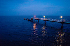 Sea pier at night Stock Images