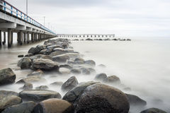 Sea, pier and rocks Stock Photos