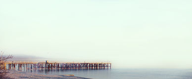 Sea pier with seagulls and clear sky Royalty Free Stock Photos