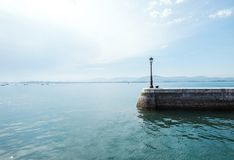 The sea pier with a street lantern on the Santander embankment. Stock Photography