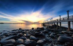 Sea pier sunrise photography. Sea pier sunrise dramatic nature photography Stock Photo