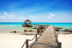 Sea with pier under blue cloudy sky. In Koh Kood, Thailand Royalty Free Stock Photography