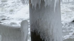 Sea pier in winter. The bridge and the fence were covered with ice, the winter sea stock video