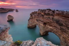 Sea pink sunset on the beach Marinha. Portugal. Royalty Free Stock Photography