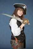 Sea pirate of a female with sabre on blue Royalty Free Stock Images