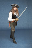 Sea pirate of a female with sabre on blue Royalty Free Stock Image