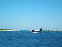 Sea Plane. Taxing to take-off from the sea stock photo