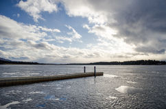 Sea Plane Dock 3. A lonely dock under a bright blue and cloudy sky Stock Image