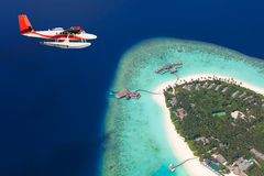 Sea plane flying above Maldives islands Stock Photography