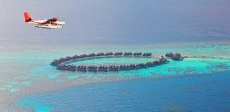 Sea plane flying above Maldives islands Stock Photography