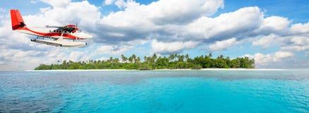 Sea plane flying above Maldives islands Stock Image