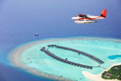 Sea plane flying above Maldives islands Royalty Free Stock Photography