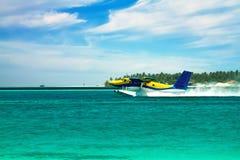 Sea plane flying above ocean Stock Photos