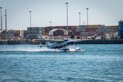 Sea Plane lands near cargo containers in Miami Florida USA Stock Images