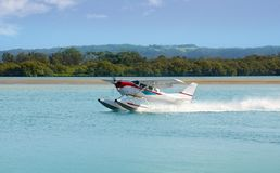 Sea Plane prepares to Take off. A floating Seaplane speeds up to take off on a sightseeing excursion on the New South Wales Coast, Australia Royalty Free Stock Photos