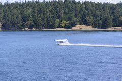 Sea Plane Taking Off in an Ocean Bay Royalty Free Stock Photography
