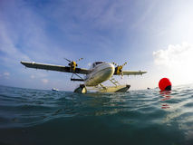 Sea plane of tropical Maldives romantic atoll island paradise lu. Close up of a bow of a luxury sea plane parked at sea Stock Photo