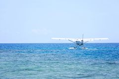 Sea plane on water. Seaplane landing on water, copy space on left Stock Images