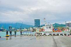 The Sea Port of Batumi. BATUMI, GEORGIA - MAY 24, 2016: The Sea Port overlooks the misty Lesser Caucasus mountains, covered with forests and seaside city royalty free stock image
