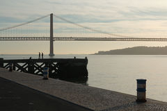 Sea port, bridge and silhouettes Royalty Free Stock Photo