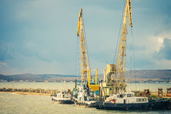 Sea port Crane and ships cargo industrial Stock Photography